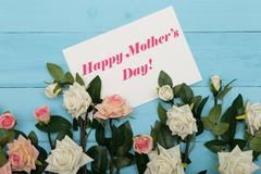 Mothers day card and  beautiful roses on blue wooden background Stock Photos