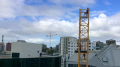 Stock Video Footage of Builders assemble a construction tower crane