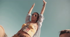 Young adult boho girl with raised arms on a road trip - stock footage