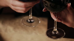 happy couple in a fine dining restaurant they drink wine and clinking glasses - stock footage