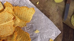 Stock Video Footage of Portion of rippled Potato Chips (not loopable)