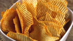 Portion of rippled Potato Chips (not loopable) Stock Footage