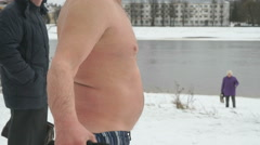 Naked man doing exercises in winter.Walrus.Health Stock Footage