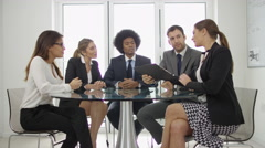 4K Confident corporate business group in discussion in boardroom meeting Stock Footage