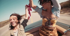 Hipster style teenager friends enjoying a road trip in America Stock Footage