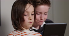 4k, Kids take selfie on their touchscreen digital tablet and making funny faces. Stock Footage