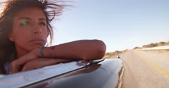Boho style girl outdoor with convertible car at sunset - stock footage