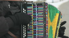 Man plays the accordion decorated with rhinestones Stock Footage
