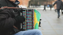 Man plays the accordion in front of the Kremlin - stock footage