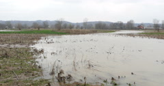 Stock Video Footage of Flooded fields at the countryside after rainstorm, cloudy dark sky, windy.