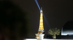Blue and yellow colored Eiffel tower shining in the dark Stock Footage