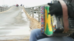 Man plays the accordion on pedestrian bridge - stock footage