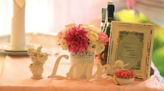 Pink and white roses bouquet with photoframe over wooden table Stock Footage