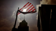 USA American flag wave backlight sun building dark sky slow motion United States Stock Footage