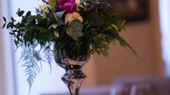 Beautiful wedding decoration made of flowers of different kinds and colors on a Stock Footage