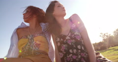 Relaxed hippie girls on the backseat on a convirtible car Stock Footage