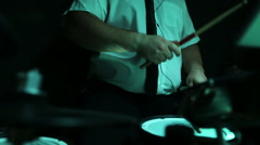 Close up of a musician with headphones  playing drums on a stage Stock Footage