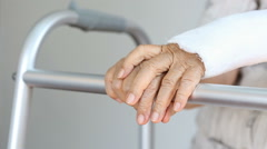 Senior woman broken wrist using walker Stock Footage