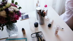 Make up brushes and proffessional cosmetics applied by artist for a wedding make - stock footage