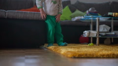 Small boy is cute in his green tights - stock footage