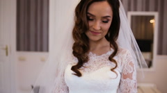 Young bride with proffessional make up and a beautiful hairstyle pose on camera - stock footage