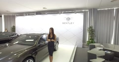 Serbia,Belgrade Bentley and sexy woman on Car Motor Moto show March 2016 Stock Footage