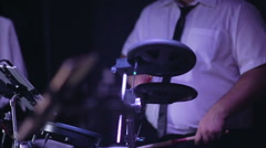 Musician wearing white shirt , black pants and a tie playing drums Stock Footage