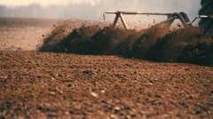 Agriculture background - farmer plowing field. CLOSE UP Stock Footage