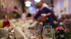 Waiters serving table in a wedding  ceremony for guests and a bride and her - stock footage