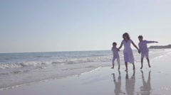 Mother Playing With Children On The Beach - stock footage