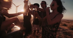 Boho Friends toasting at sunset with beer and pizza - stock footage