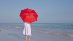 Elegant Woman In White Dress Walking Beach With Red Umbrella Stock Footage
