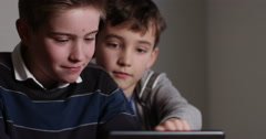 4k, Young students in a classroom on a digital tablet. Slow motion. - stock footage