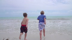 Boys Playing On Beach Together In Florida Keys Slow Motion - stock footage