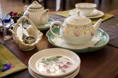 Tea table with many utensil, prepared for tea time, selective focus Stock Photos