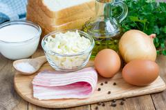 Ingredients for mini quiche with bacon, using bread toast instead of dough Stock Photos