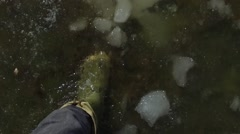 Boots walking through slush and ice pov slow motion Stock Footage