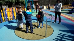 Little fun boy happy having fun on the children entertainment area. Stock Footage