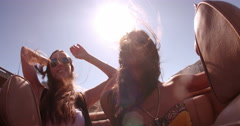 Hipster boho girl friends enjoys a summer road trip - stock footage