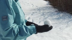 slow motion snowball ready for throwing - stock footage