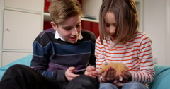 Stock Video Footage of 4k, Two kids play with their pet hamster at home. Slow motion.