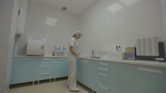 Dental nurse preparing medical instruments Stock Footage