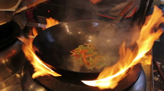 Amazing cooking skills. Cook frying vegetables at open fire. Asian food fest Stock Footage
