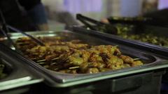 Mediterranean cuisine. Grilled shrimps on sticks. Appetizing street food - stock footage