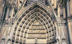 Stock Photo of Old patterns, front facade of high and tourism Cologne-Dom