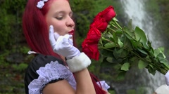 Pretty Young Cosplay Teen Girl With Red Bouquet Of Roses Stock Footage