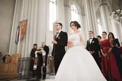 Wedding couple bide and groom get married in a church - stock photo