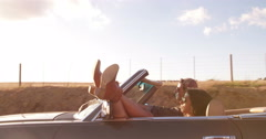 Adventurous teenage couple on a road trip with convertible Stock Footage
