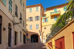 Narrow street in Menton, France. Stock Photos