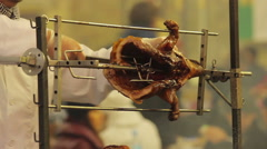 Poor sanitation. Street cook cutting pieces grilled pig. Unhealthy, fatty food Stock Footage